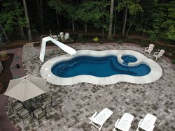 <div class='closebutton' onclick='return hs.close(this)' title='Close'></div><div class='firstH'><img src='images/logo-white-small.png'></div><h1>Free Form Fiberglass Pool</h1><p>Free Form - Laguna Deluxe Fiberglass Pool #002 by Stoker Pools</p><div class='getSocial'><h1>Share</h1><p class='photoBy'>Photo by Stoker Pools</p><iframe src='http://www.facebook.com/plugins/like.php?href=http%3A%2F%2Fstokerpools.com&send=false&layout=button_count&width=100&show_faces=false&action=like&colorscheme=light&font&height=21' scrolling='no' frameborder='0' style='border:none; overflow:hidden; width:100px; height:21px;' allowTransparency='true'></iframe><br><a href='http://pinterest.com/pin/create/button/?url=http%3A%2F%2Fwww.stokerpools.com&media=http%3A%2F%2Fwww.stokerpools.com%2Fimages%2Fgalleries%2Fconcrete%2Fwm%2Fconcrete-pool-by-stoker-pools-001.jpg&description=Pools' data-pin-do='buttonPin' data-pin-config=\'above\'><img src='http://assets.pinterest.com/images/pidgets/pin_it_button.png' /></a><br></div>
