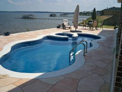 <div class='closebutton' onclick='return hs.close(this)' title='Close'></div><div class='firstH'><img src='images/logo-white-small.png'></div><h1>Free Form Fiberglass Pool</h1><p>Free Form - Laguna Deluxe Fiberglass Pool #004 by Stoker Pools</p><div class='getSocial'><h1>Share</h1><p class='photoBy'>Photo by Stoker Pools</p><iframe src='http://www.facebook.com/plugins/like.php?href=http%3A%2F%2Fstokerpools.com&send=false&layout=button_count&width=100&show_faces=false&action=like&colorscheme=light&font&height=21' scrolling='no' frameborder='0' style='border:none; overflow:hidden; width:100px; height:21px;' allowTransparency='true'></iframe><br><a href='http://pinterest.com/pin/create/button/?url=http%3A%2F%2Fwww.stokerpools.com&media=http%3A%2F%2Fwww.stokerpools.com%2Fimages%2Fgalleries%2Fconcrete%2Fwm%2Fconcrete-pool-by-stoker-pools-001.jpg&description=Pools' data-pin-do='buttonPin' data-pin-config=\'above\'><img src='http://assets.pinterest.com/images/pidgets/pin_it_button.png' /></a><br></div>